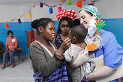 200, Ginot Razafindranaivo, male, 14 months old, UCL, before with mother Monica Ranorosoa. Handing Ginot over to Anesthesiologist Roberta Toto from Italy.<br /> <br /> Hospital Joseph Ravoahangy Andrianavalona.  Operation Smile's 2015 mission to Antananarivo - Madagascar. 10th -18th April 2015.<br /> <br /> (Operation Smile Photo - Zute Lightfoot)