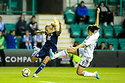 *CORR* Foteini Andronikou (#6) of Cyprus lunges to block the attempted shot from Claire Emslie (#18) of Scotland during the Women's Euro Qualifiers match between Scotland Women and Cyprus Women at Easter Road, Edinburgh, Scotland on 30 August 2019.