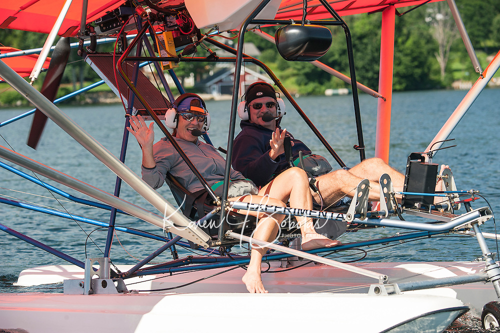 Pamela and Keith Markley sit back and relax as they prepare to take off from Center Harbor Bay in their Quicksilver Seaplane on Friday morning.  (Karen Bobotas/for the Laconia Daily Sun)