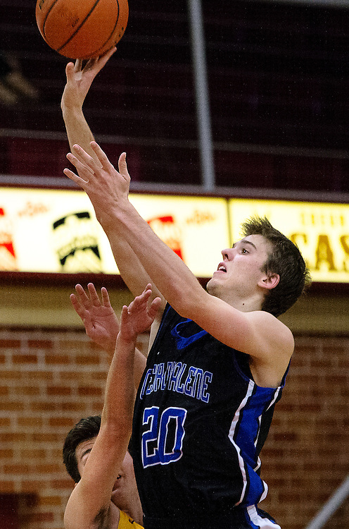 GABE GREEN/Press<br /> <br /> Justin Carpenter of Coeur d&rsquo;Alene High elevates to score two points against Kelowna during the second night of the Coeur d&rsquo;Alene Inn-Vitational.
