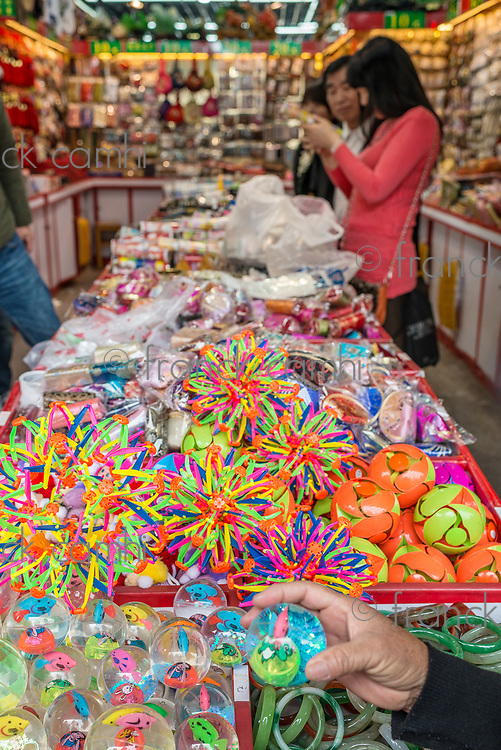 Shanghai, China - April 7, 2013: people in a souvenirs store in gucheng park at the city of Shanghai in China on april 7th, 2013