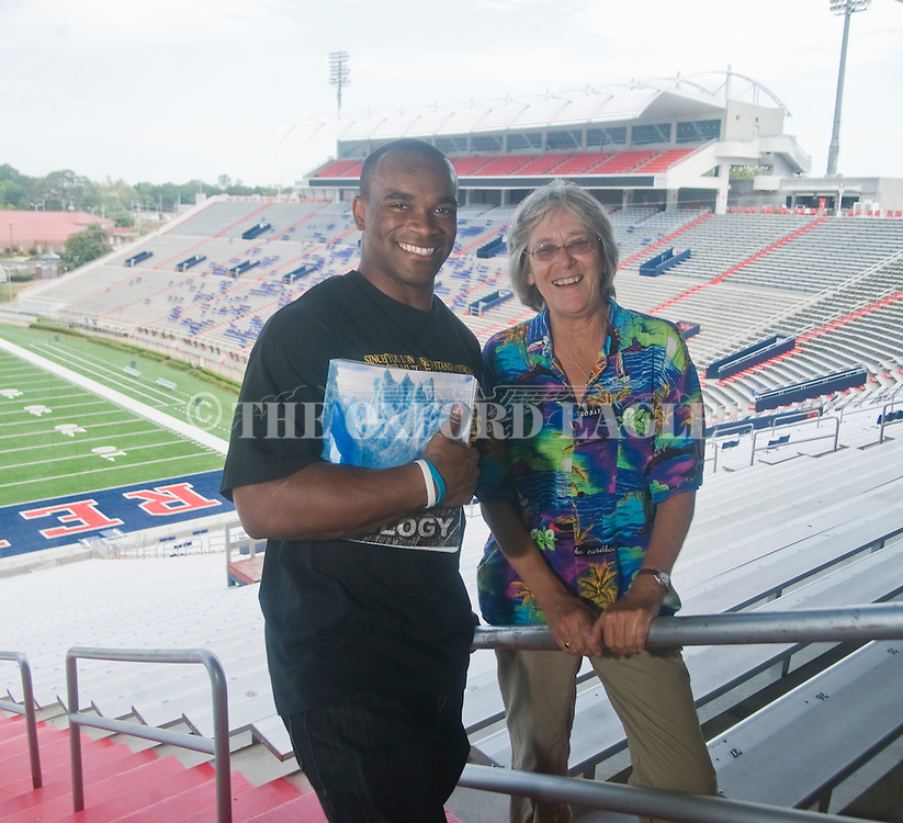 University of Mississippi football player Devin Thomas with geology instructor Cathy Grace at Vaught-Hemingway Stadium in Oxford, Miss. on Wednesday, August 17, 2011. Photo by Bruce Newman