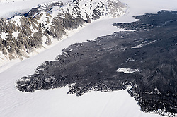 A 4,000-foot-high mountainside released approximately 120 million metric tons of rock in 60 seconds during a landslide onto the Lamplugh Glacier in Glacier Bay National Park and Preserve. In an interview with the Anchorage Dispatch News, geophysicist Colin Stark of Columbia University's Lamont-Doherty Earth Observatory, described the slide as &ldquo;exceptionally large.&rdquo; He compared the massive landslide to roughly 60 million medium SUVs tumbling down a mountainside.<br /> <br /> The slide occurred on the morning of June 28  in a remote area of Glacier Bay National Park in southeast Alaska. It was first observed by Paul Swanstrom, pilot and owner of Haines-based Mountain Flying Service. Swanstrom noticed a huge cloud of dust over the Lamplugh Glacier during a flightseeing tour of Glacier Bay National Park several hours after the slide occurred. Swanstrom estimates the debris field to be 6.5 miles long, and one to two miles in width.<br /> <br /> This aerial photo of the Lamplugh Glacier landslide was taken two days after the landslide.