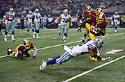 Dallas Cowboys wide receiver Terrance Williams (83) dives for yardage after catching a first quarter pass that gives the Cowboys first and goal at the 8 yard line during the NFL week 6 football game against the Washington Redskins on Sunday, Oct. 13, 2013 in Arlington, Texas. The Cowboys won the game 31-16. ©Paul Anthony Spinelli