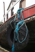 Tractor tyre on the side of a boat in Galway ireland