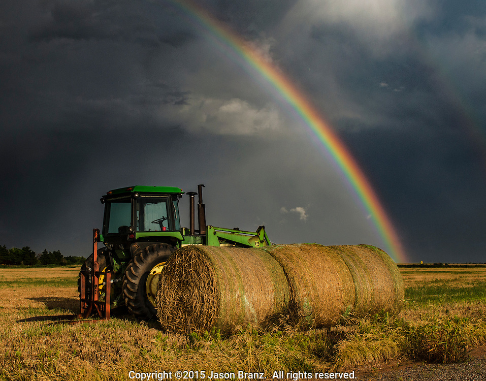 Farm equipment in a thunderstorm, Oklahoma.