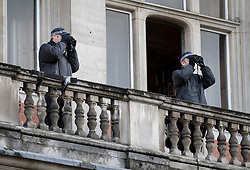 © Licensed to London News Pictures. 12/11/2017. London, UK. Police watch from a balcony during a security operation over Horse Guards Road during the Remembrance Sunday Ceremony at the Cenotaph in Whitehall. Photo credit: Peter Macdiarmid/LNP
