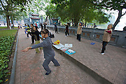 Hoan Kiem Lake. Morning sports. Tai Chi near Ngoc Son (Jade Mountain) Temple.