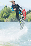 Male athlete wake boarding on the Snake River in Burley, Idaho.