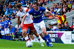 Liam Mandeville of Chesterfield looks for options while being chased down by Billy Jones of Rotherham United - Mandatory by-line: Ryan Crockett/JMP - 20/07/2019 - FOOTBALL - Proact Stadium - Chesterfield, England - Chesterfield v Rotherham United - Pre-season friendly