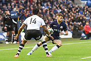 Tommy Seymour side steps Metui Talebula during the 2018 Autumn Test match between Scotland and Fiji at Murrayfield, Edinburgh, Scotland on 10 November 2018.