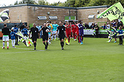 The two teams enter the field during the EFL Sky Bet League 2 match between Forest Green Rovers and Swindon Town at the New Lawn, Forest Green, United Kingdom on 25 August 2018.