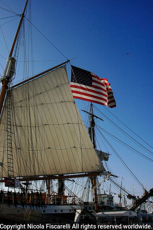 An  American flag flies on the  sail boat in San Diego Marina California.
