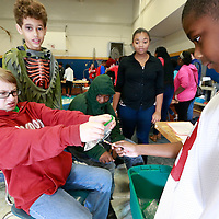 "Thomas Wells | BUY AT PHOTOS.DJOURNAL.COM<br /> nicholas Gassoway, 12, left, begisn to reaact as Jayvion Blanchard, 11, begin to push a sharpened pencil through a ""polymer"" lined bag filled with water. The experiment shows students how the polymers bond to the pencils and not allowing the water to leak out."