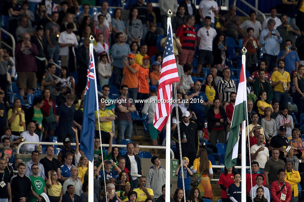 The flags of the USA's Gold (C New Zealand Silver (L) and Hungry Bronze during a medal ceremony for the Women's Shot Put in Olympic Stadium at the 2016 Rio Olympics on Saturday the 13th of August 2016. © Copyright Photo by Marty Melville / www.Photosport.nz