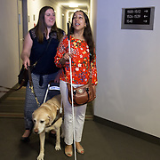 ARLINGTON, VA -JUNE3:  Tiffany Jolliff, walks with lawyer Deepa Goraya, from the the Washington Lawyers' Committee for Civil Rights and Urban Affairs, after they filed a lawsuit Thursday in federal district court in the Eastern District of Virginia on behalf of Tiffany Jolliff against Uber, alleging violations of the Americans With Disabilities Act and the Virginians with Disabilities Act, alleging Uber unlawfully refused to accommodate Jolliff, who is blind, and her service dog, Railey. The complaint alleges that Jolliff, who works as a policy specialist for the federal government on employment for workers with disabilities, has been repeatedly discriminated against and denied Uber's services when Uber's drivers have seen that she is accompanied by her service dog Railey. Specifically, instead of accommodating her service dog Railey, as both the ADA and VDA require, Uber drivers have repeatedly driven off upon seeing that Ms. Jolliff had a service dog. (Photo by Evelyn Hockstein/For The Washington Post)