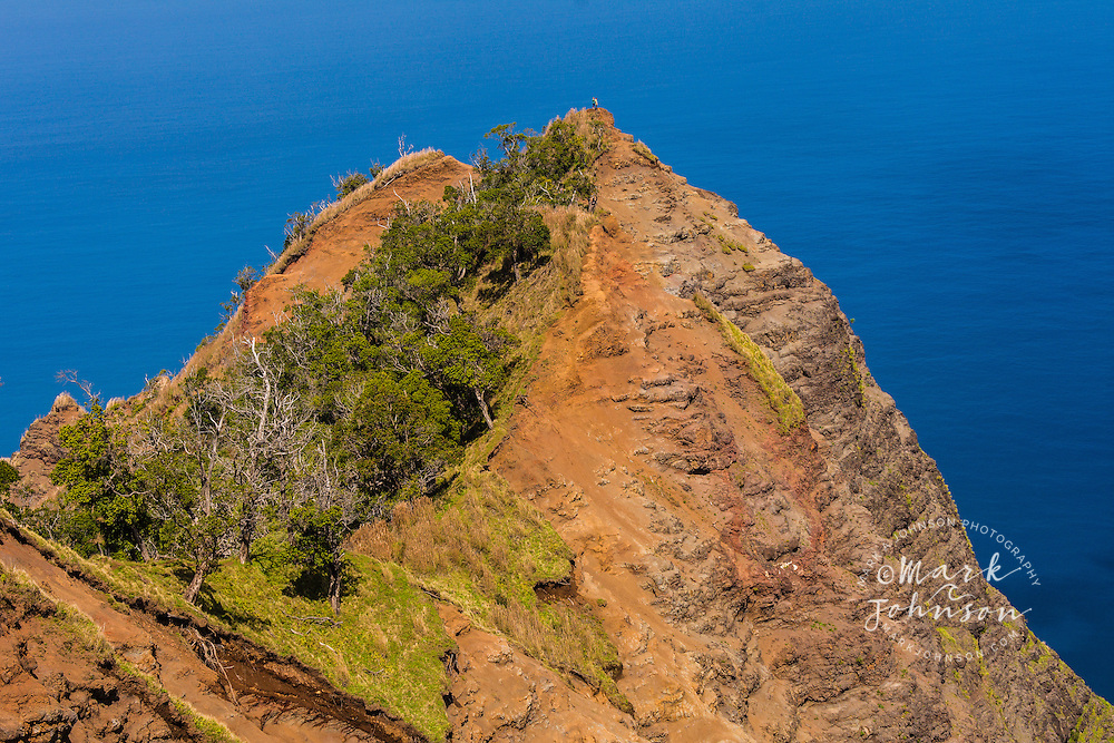 Hikers on a peak above Kalalau Valley on the Na Pali Coast, Kokee, Kauai, Hawaii