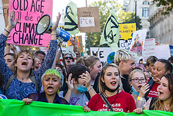 London, UK. 20 September, 2019. Anna Taylor (c), co-founder of UK Student Climate Network, marches with students and climate campaigners during the second Global Climate Strike in protest against a lack of urgent action by the UK Government to combat the global climate crisis. The Global Climate Strike grew out of the Fridays for Future movement and is organised in the UK by the UK Student Climate Network.