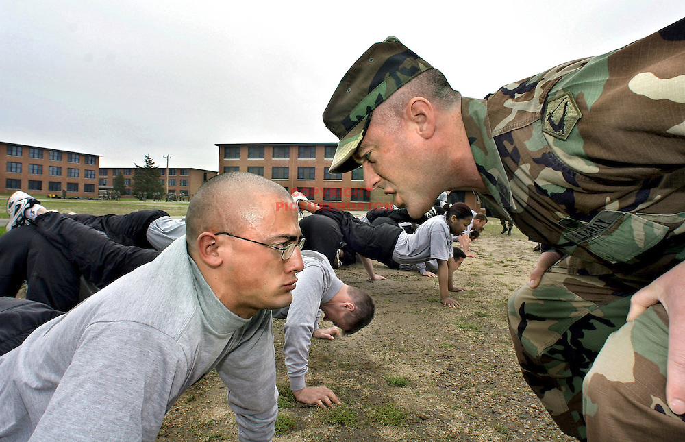 New recruit Daniel Soloperto (at left) and others,  are put through physical training from Massachusetts Army National Guard Sgt Steven Post.