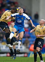 Wigan, England - Sunday, January 21, 2007: Wigan Athletic's Lee McCulloch and Everton's Joseph Yobo during the Premier League match at the JJB Stadium. (Pic by David Rawcliffe/Propaganda)