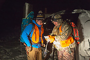 In the pre-dawn glow of a headlamp, Chinese student Li Haoxin (Luke) checks the map prior to a hunt for deer and elk with his friend and roommate, Jack Crowley, near Alder, Montana,