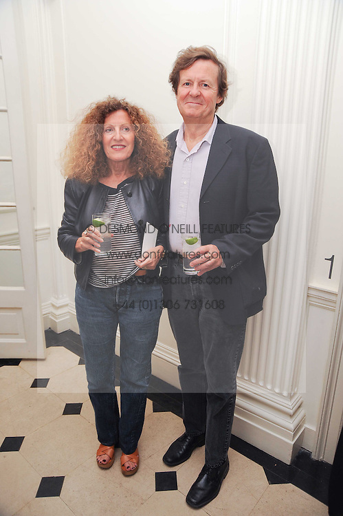 SIR DAVID HARE and his wife fashion designer NICOLE FARHI at a party to celebrate the launch of Page One an online guide to London's 100 most rewarding restaurants held at the Halcyon Gallery, Bruton Street, London on 7th July 2010.