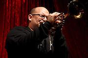 Farnell Newton blowing his trumpet at Jimmy Maks