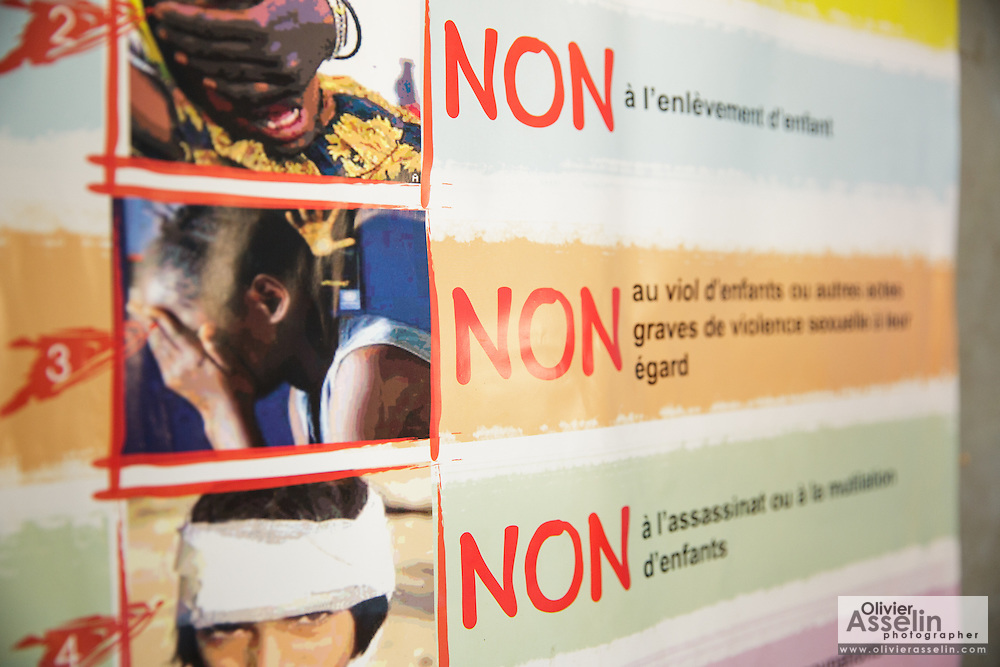 Poster denouncing crimes against children at the police station in Katiola, Cote d'Ivoire on Saturday July 13, 2013.