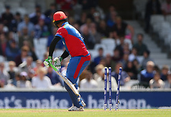 Afghanistan's Noor Ali Zadran is bowled by England's Ben Stokes during the ICC Cricket World Cup Warm up match at The Oval, London.