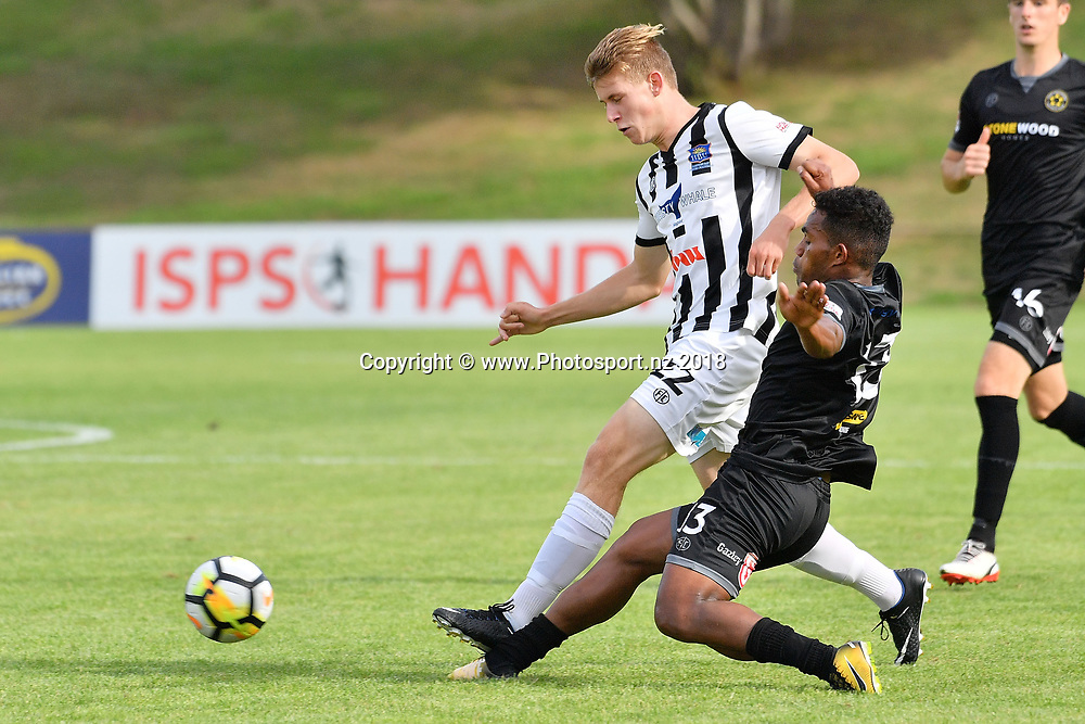Hawkes Bay's Jorge Akers (Back) is tackled by Team Wellington's Roy Kayara during the ISPS Handa Premiership soccer match between Team Wellington and Hawkes Bay at Porirua Park in Porirua on Sunday the 21st January 2018. Copyright Photo by Marty Melville / www.Photosport.nz