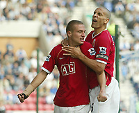 Photo: Aidan Ellis.<br /> Wigan Athletic v Manchester United. The Barclays Premiership. 14/10/2006.<br /> United's Rio Ferdinand celebrtates with first goal scorer Nemanja Vidic
