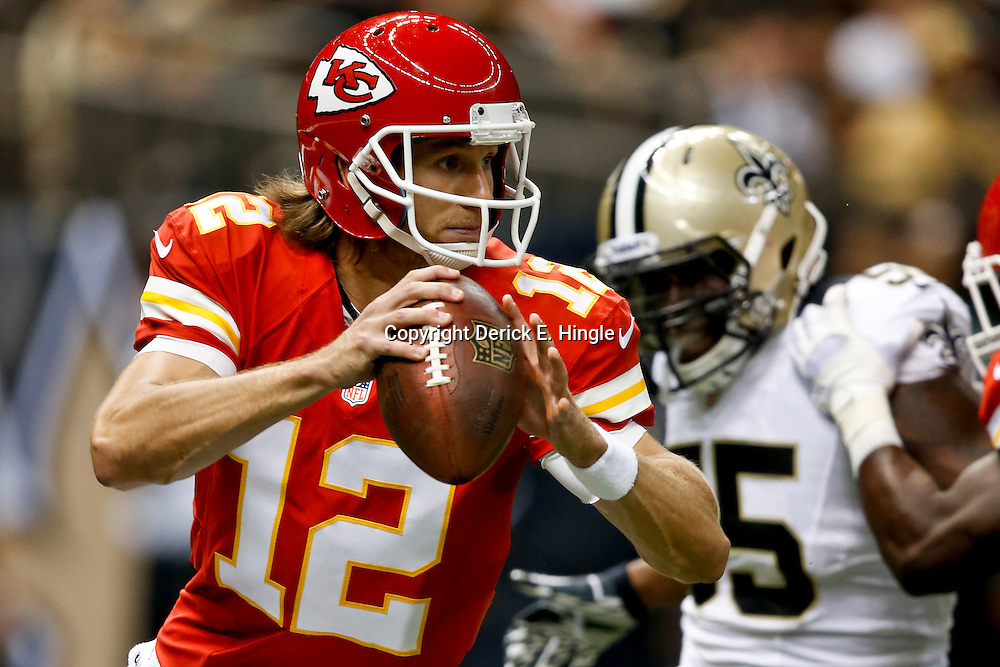 Aug 9, 2013; New Orleans, LA, USA; Kansas City Chiefs quarterback Ricky Stanzi (12) is pressured by New Orleans Saints linebacker Eric Martin (55) during the second half of a preseason game at the Mercedes-Benz Superdome. The Saints defeated the Chiefs 17-13. Mandatory Credit: Derick E. Hingle-USA TODAY Sports