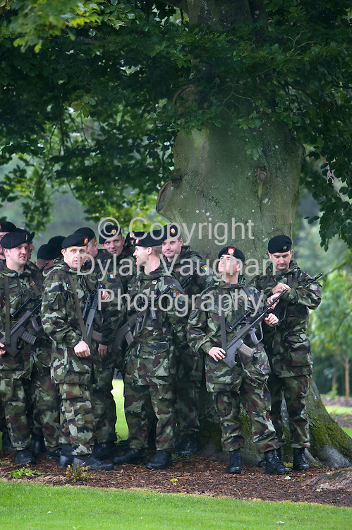 10/9/2008.Members of the 98th Infantry Battalion bound for  overseas service in Chad pictured taking shelter from the rain in the Castle Park in Kilkenny yesterday ahead of the arrival of The Minister for Defence, Mr. Willie O'Dea T.D for the Ministerial Review of Troops Bound for Chad..Picture Dylan Vaughan.