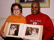 Roberta and Kenneth Screven, holding their wedding album (from December 24, 1966) on Saturday, January 27, 2007.
