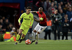 MANCHESTER, ENGLAND - Thursday, April 11, 2019: Barcelona's Philippe Coutinho (L) and Manchester United's Ashley Young during the UEFA Champions League Quarter-Final 1st Leg match between Manchester United FC and FC Barcelona at Old Trafford. (Pic by David Rawcliffe/Propaganda)