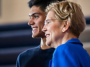 "21 OCTOBER 2019 - DES MOINES, IOWA: US Senator ELIZABETH WARREN (D-MA) poses for ""selfies"" with students after talking to about 500 students during an assembly at Roosevelt High School in Des Moines. Sen. Warren talked to students about her journey from childhood in Oklohoma to running for the US Presidency. Sen. Warren is campaigning to be the Democratic nominee for the US presidency in Iowa this week. Iowa traditionally hosts the the first selection event of the presidential election cycle. The Iowa Caucuses will be on Feb. 3, 2020.                 PHOTO BY JACK KURTZ"