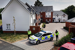 © Licensed to London News Pictures. 04/07/2018. Amesbury, UK. Police stand at the entrance of a property in Muggleton Road, Amesbury after a couple named locally as Dawn Sturgess, 44, and her partner Charlie Rowley, 45, were taken ill on Saturday 30th June 2018. Police have confirmed that the couple have been in contact with Novichok nerve agent. Former Russian spy Sergei Skripal and his daughter Yulia were poisoned with Novichok nerve agent in nearby Salisbury in March 2018.Photo credit: Peter Macdiarmid/LNP