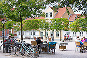 Al fresco dining at street cafe restaurant in Gront Torvet square in old town Odense on Funen Island, Denmark
