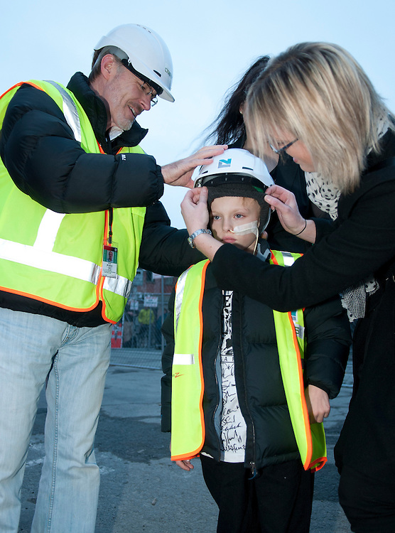 Six-year-old cancer patient Jayden Halliwell gets ready for his demolition task  on earthquake damaged Radio Network House in a New Zealand's first controlled Implosion of a building, Christchurch ,  New Zealand,  Sunday, August 5, 2012. Credit:  SNPA / David Alexander.