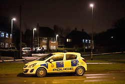 © Licensed to London News Pictures. 20/02/2016. Leeds UK. A police cordon & forensic tent can be seen at the rear of the Omnibus pub on Sharp Lane in Middleton, Leeds. Unconfirmed reports suggest a Police officer has been injured in a hit & run incident. Police are treating the incident as attempted murder. Photo credit: Andrew McCaren/LNP