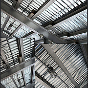 Looking up at the underside of scaffolding.<br /> <br /> The scaffolding company provides the scaffold and shoring erection and dismantle services.<br /> <br /> Scaffolding  is a temporary structure for holding workers and materials during the erection, repair, or decoration of a building.