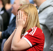 Boro supporter cannot believe her eyes as Fulham score again during the Sky Bet Championship match between Fulham and Middlesbrough at Craven Cottage, London, England on 25 April 2015. Photo by Matthew Redman.