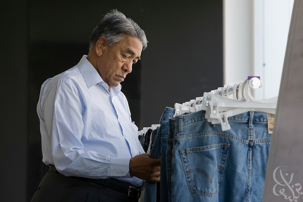 Air Marshal Man Mohan Sinha, chairman of Velocity Apparelz CO checks the quality of his manufactured blue jeans October 27, 2008 at the Velocity jeans factory in Ismailia (130 kilometers north of Cairo, Egypt.)  Sinha and his son Siddharth, CEO of the parent company Vogue International Agencies FZE are Indian businessmen who have been operating their jeans company in Egypt since 2001, employing 2700 Egyptian workers while supplying jeans to major companies that include Levis, Target, and Zara.