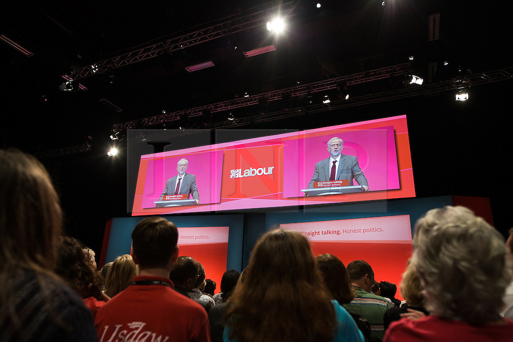 © Licensed to London News Pictures . 29/09/2015 . Brighton , UK . The audience listen as JEREMY CORBYN delivers his speech to the 2015 Labour Party Conference . Photo credit : Joel Goodman/LNP