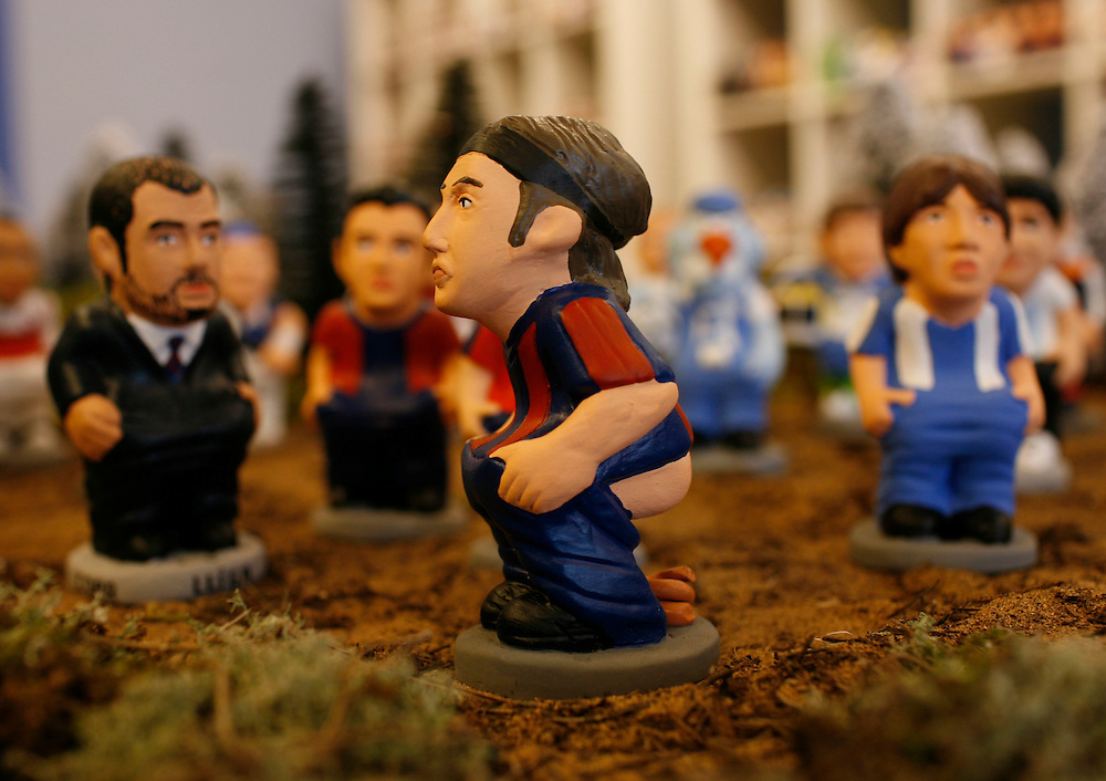 "Torroella de Mongri, Spain, 19 November 2009. .A company in Torroella de Montgrí (Girona, Spain) called ""caganer.com"" specialized in the production of ""caganers"" unveiled today  the new figures for Christmas as F.C. Barcelona player, Zlatan Ibrahimovic..A ""Caganer"" is a small figure from Catalonia, usually made of fired clay,  and depicted as squating person in the act defecating. .""Caganer"" is Catalan for pooper. It fomrs part of one of the typical figures of  the manger or ""Nativity"" scene together with Mary, .Joseph and the baby Jesus but hidden in a corner. It is a humorous figure, originally portraying a peasant wearing a .barretina (a red stocking hat), and seems to date from the 18th century when it  was believed that the figure's depositions  .would fertilize the earth to bring a properous year. With  the course of the time, the original  personage of this pooping figure .was  substituted with personalities from the political and sports world and other famous personalities."