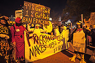 Anti-fracking participants in the Occupy Wall Street movement march in the Greenwich Village Annual Halloween Parade.