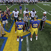 Delaware and University of Maine players meet at midfield for the coin toss prior to a Week 6 NCAA football at Delaware.