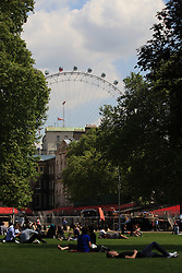 © Licensed to London News Pictures. London, UK. 15/05/2014. London, UK. People enjoy the sunshine in St James Park, central  London, today (15/05/2014). Temperatures has risen to 24C as Britain may face the hottest May on record. Photo credit: LNP