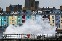 Aberystwyth Wales UK, Christmas Day,  Sunday 25 December 2017<br /> <br /> UK Weather: Strong gale force winds, gusting to over 40mph,  and the high tide combine to whip huge waves crashing into the sea defences on the promenade in Aberystwyth on the west coast of Ceredigion, Wales<br /> <br /> <br /> photo © Keith Morris