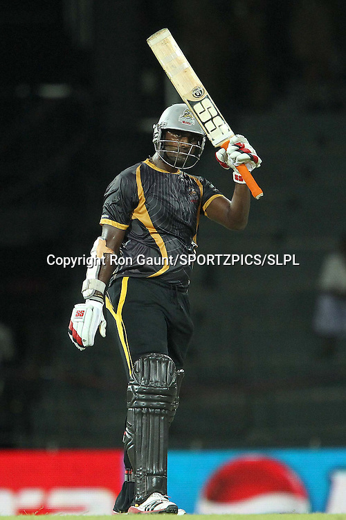 Thisara Perera celebrates his half century during match 5 of the Sri Lankan Premier League between Kandurata Warriors and Nagenahira Nagas held at the Premadasa Stadium in Colombo, Sri Lanka on the 13th August 2012<br />  <br /> Photo by Ron Gaunt/SPORTZPICS/SLPL